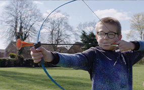 Young boy doing archery